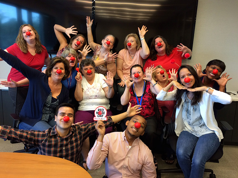 Fun group shot of Argo Employees wearing red noses