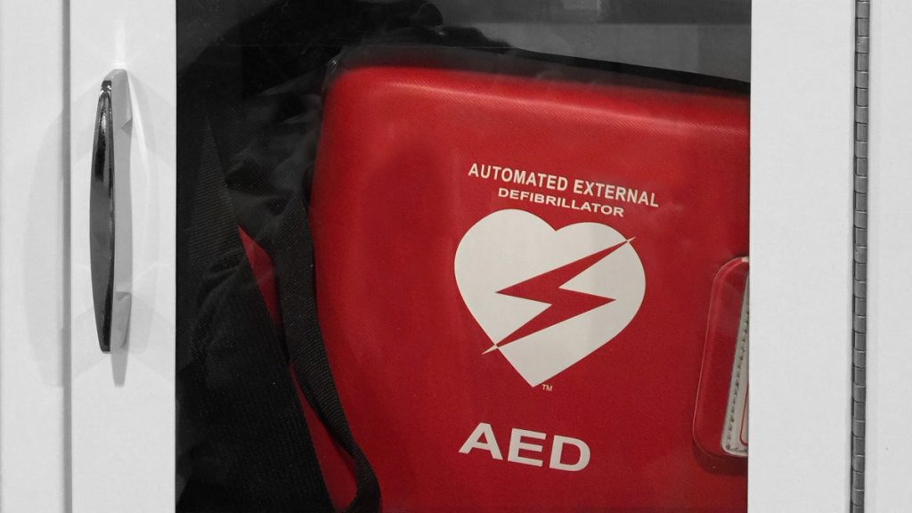 Automated external defibrillator in glass case