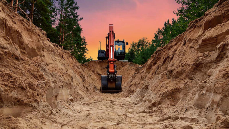 Excavator digging a large trench