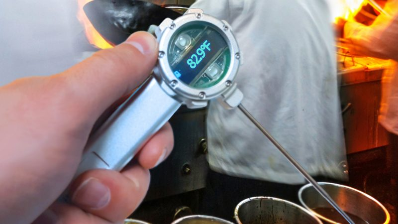 Hand holding thermal gauge with digital readout