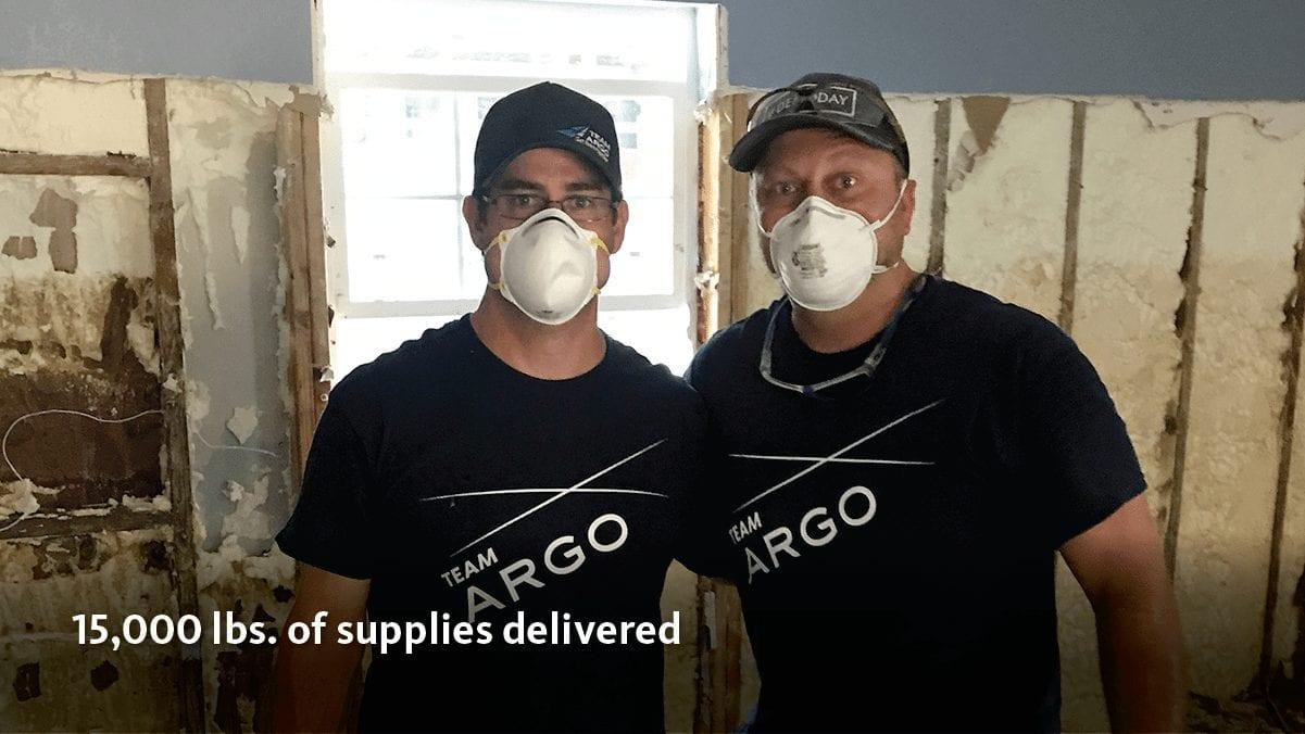 Two men wearing masks doing home demolition