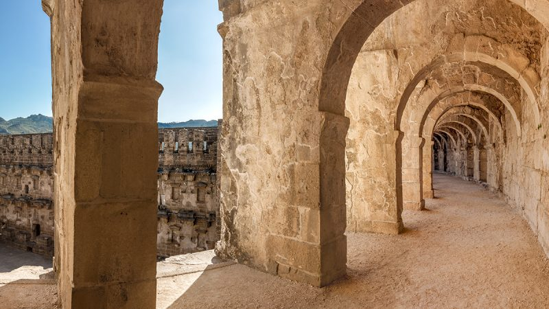 Top passageway in the theatre of Aspendos including arcade and a view of amphitheater