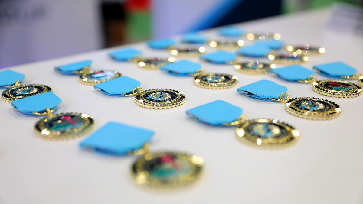 Pins with light blue ribbon laid out on a table