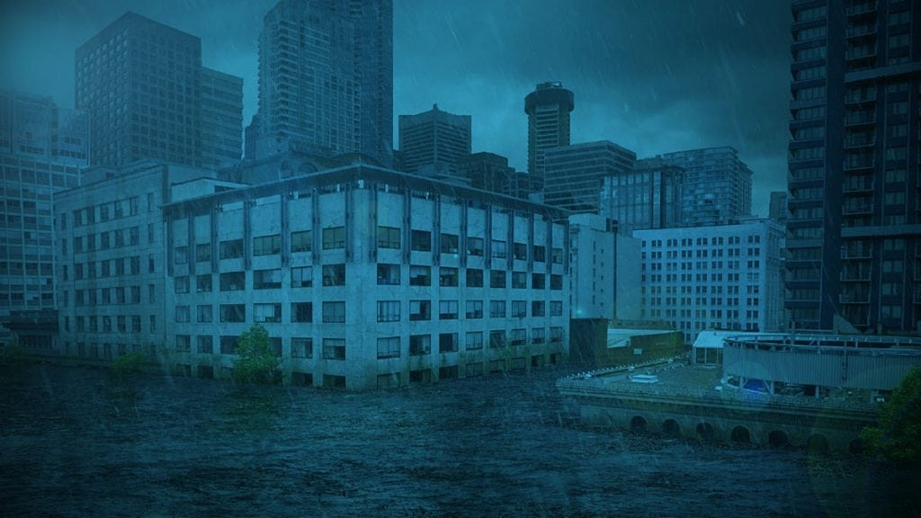 Floodwaters rising high in downtown urban environment