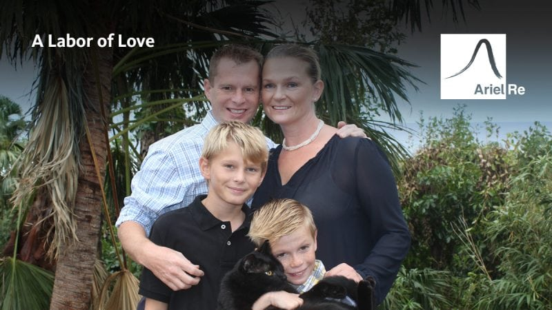 Ariel Re employee Matthew Wilken posing with wife and two young boys