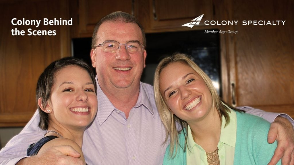 Colony Specialty employee Dan Folkes posing with two young women