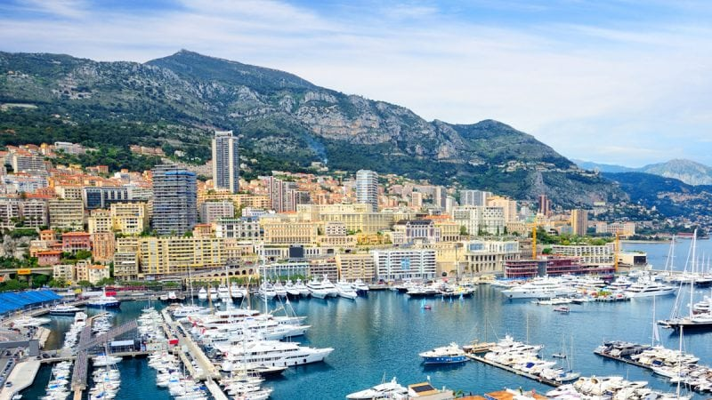 Yachts and other sailboats moored in a harbor in Monte Carlo