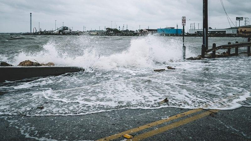 Water crashing over bridge during Hurricane Harvey in Kemah, Texas