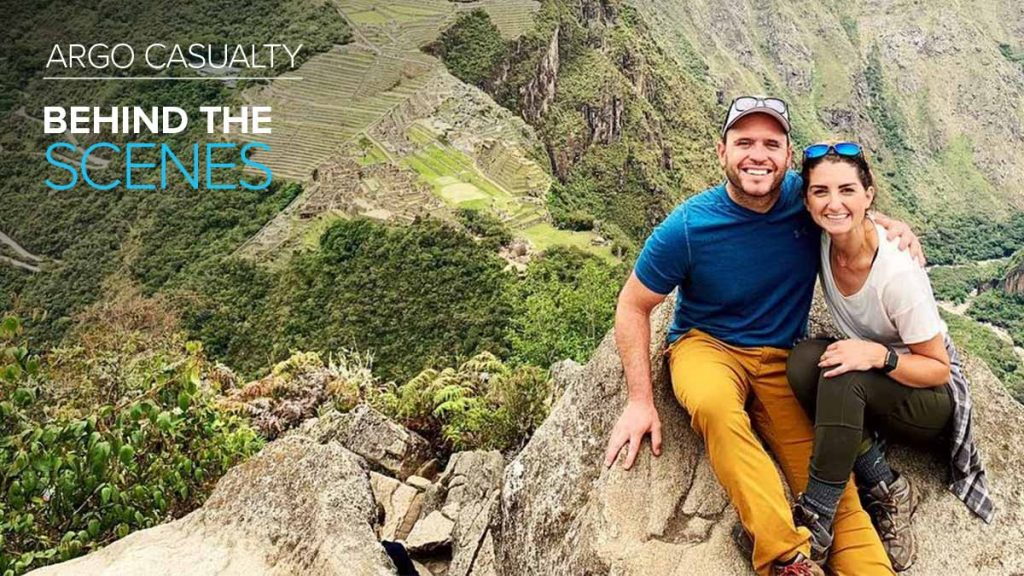 Argo Casualty employee Chris Schramm posing with woman on scenic cliff