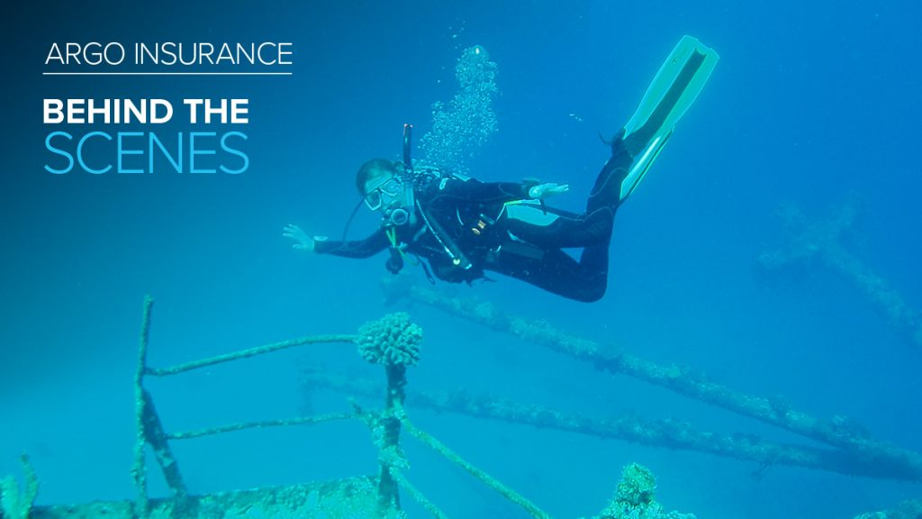 Argo Insurance employee Helen Campbell in scuba gear underwater