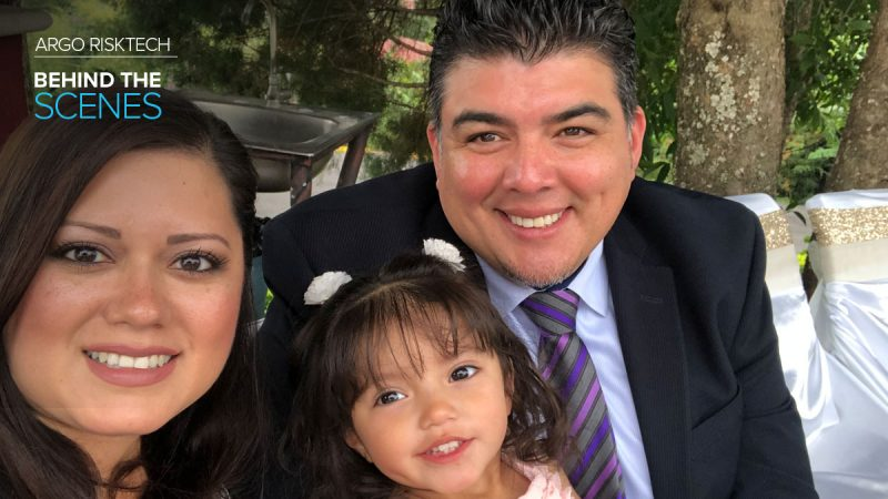 Argo Risk Tech employee Adam Lopez poses with wife and daughter at outdoor wedding