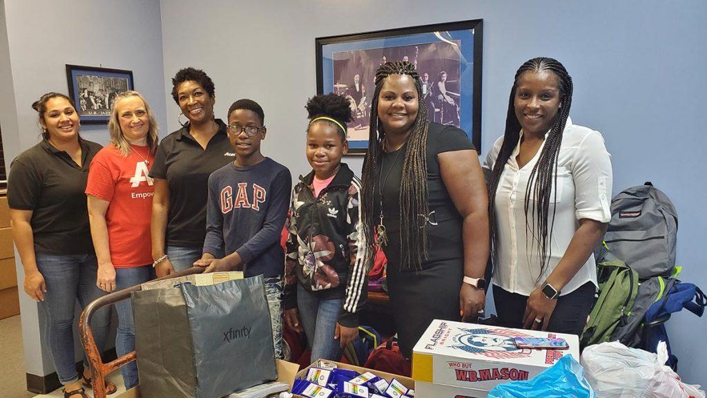 Argo Surety staff donating items to school children