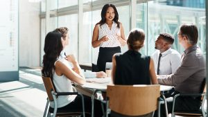 Underwriters hold a meeting around a small conference table