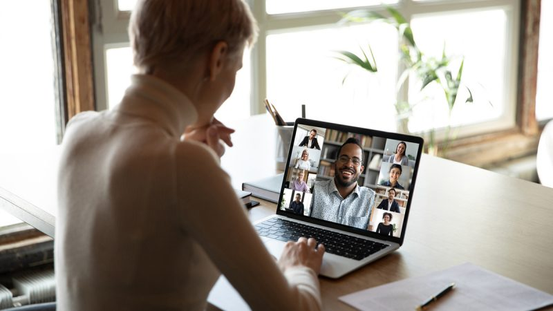 Diverse people engaged at online group meeting computer screen view