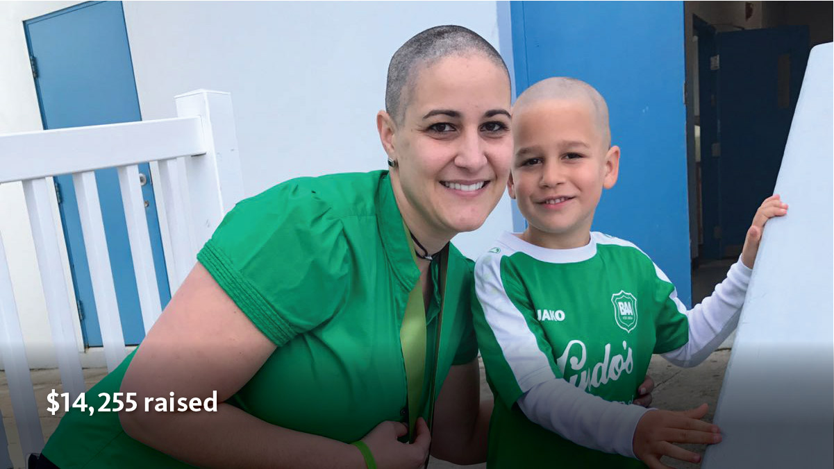 Woman and child with shaved heads, wearing green