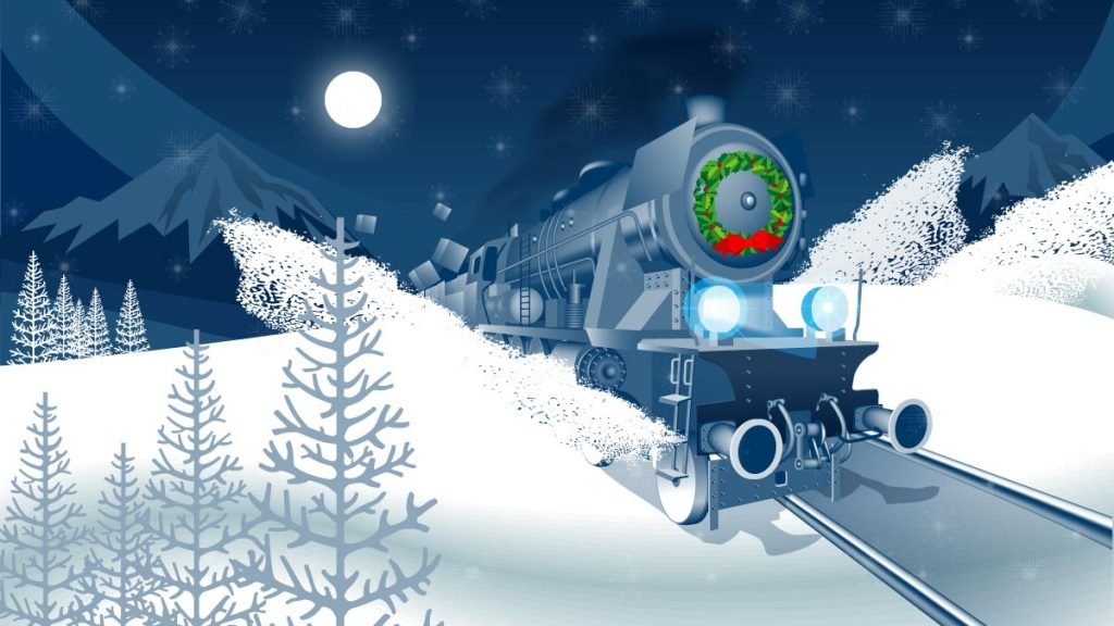 Holiday train traveling along snowy track at night