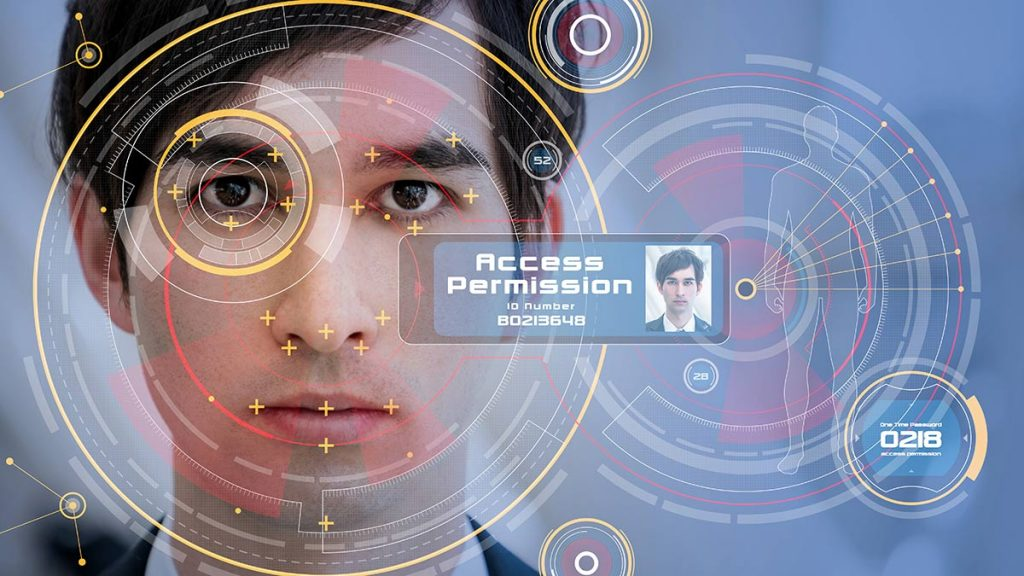 Man staring into facial recognition screen