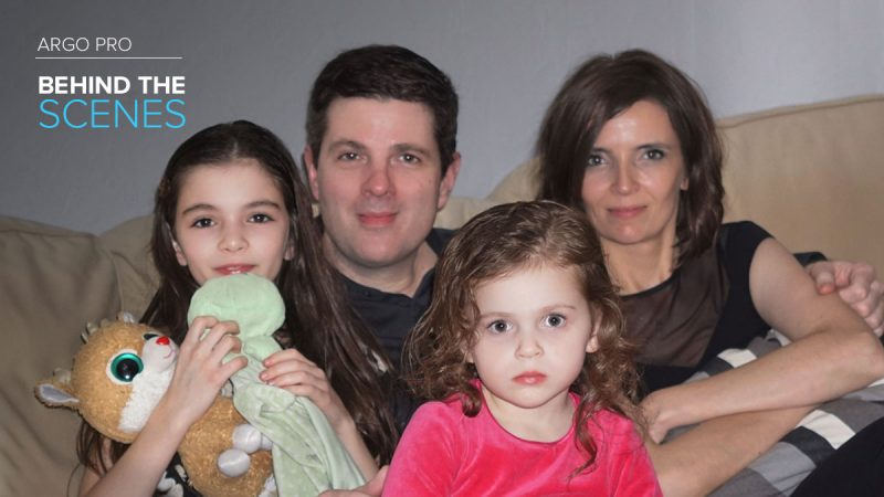 Argo Pro employee David Dineen posing on the couch with his wife and two daughters