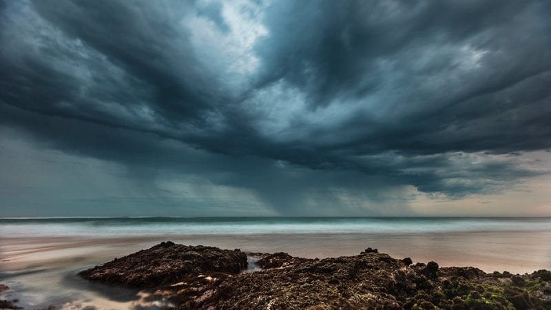 Ominous storm clouds over water