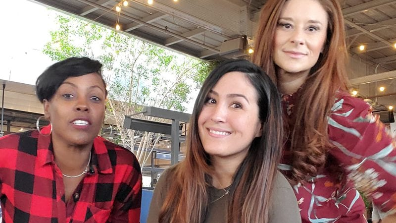 Stefanie Almada poses with two girlfriends