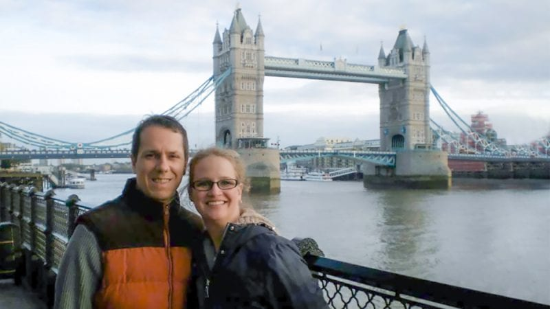 Walt Weimar and his wife posing in front of the London Bridge