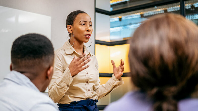 Young Black businesswoman speaking to a group