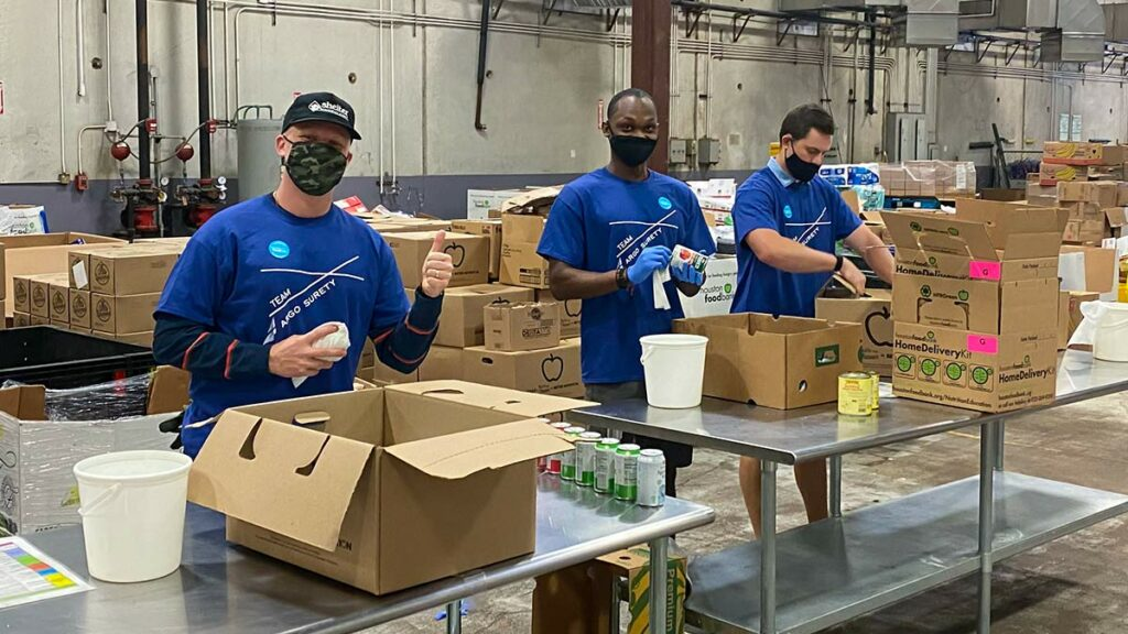 Argo Surety employees volunteering at Houston food bank