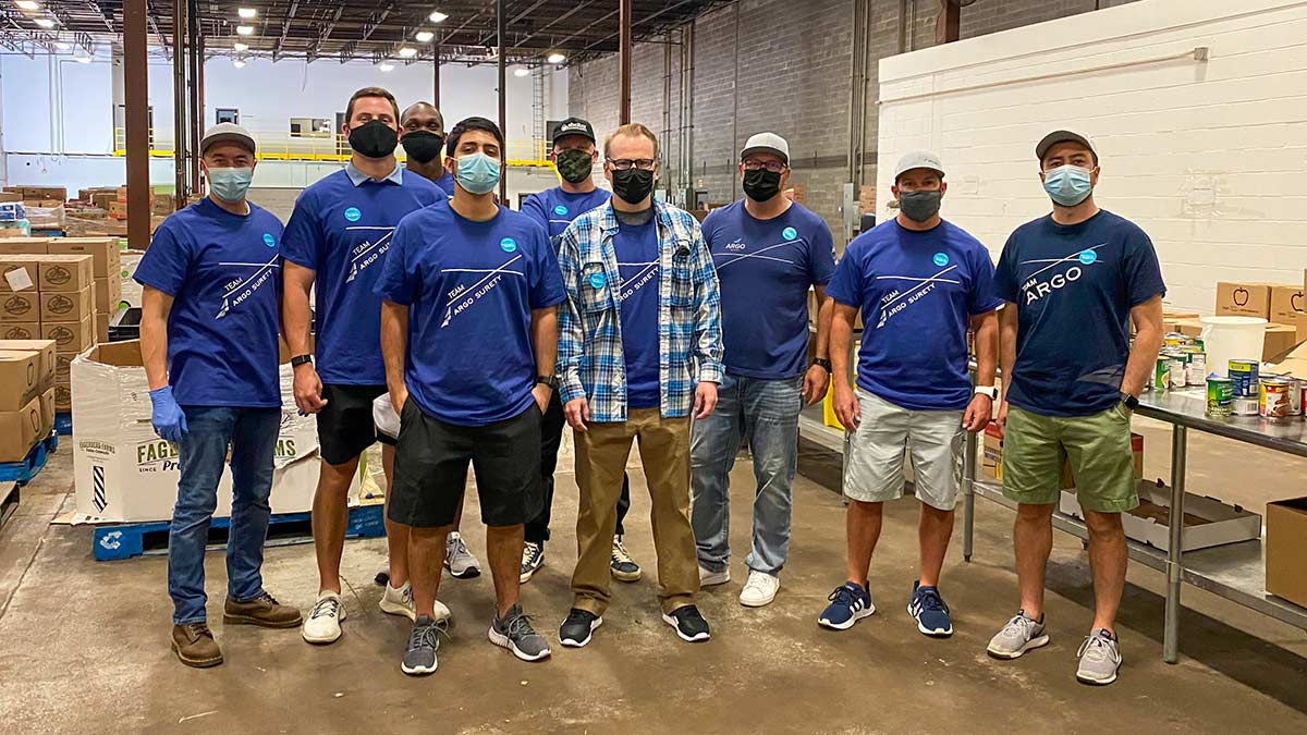 Argo Surety employees take a group photo at Houston food bank
